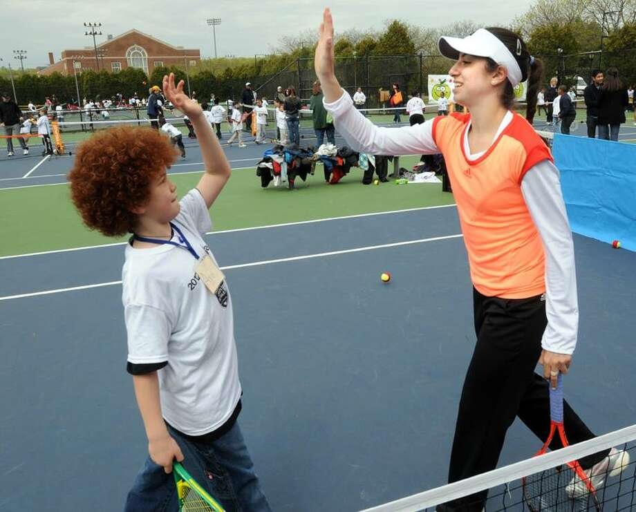 Tennis professional Christina McHale from Englewood Cliffs, NJ participated in the First Niagara Play Day at the CT Tennis Center for New Haven first and second grade school children including Edgewood School second grader Ayo Engel-Halfkenny.  Mara Lavitt/New Haven Register4/26/12