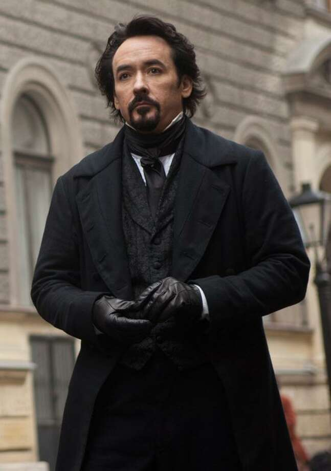 "Larry Horricks/Relativity Media photo: John Cusack portrays Edgar Allan Poe in the gothic thriller ""The Raven."" Photo: AP / © 2011 Amontillado Productions, LLC.  All rights reserved."