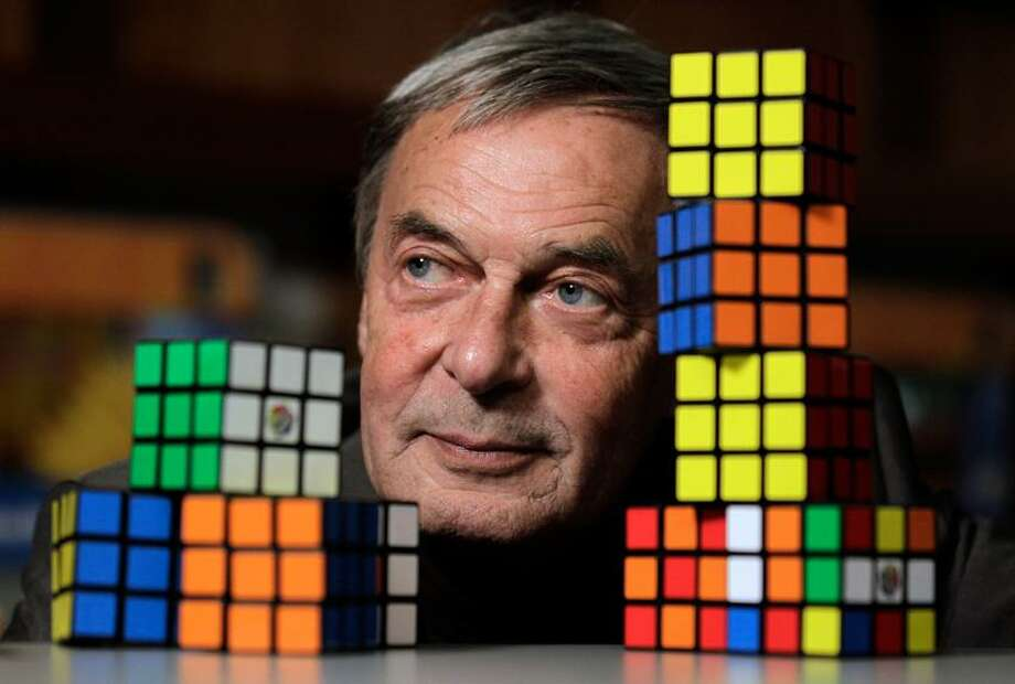 Erno Rubik, the inventor of the Rubik's Cube, poses for The Associated Press at Liberty Science Center, Wednesday, April 25, 2012, in Jersey City, N.J. The center is hosting an exhibit on Rubik's Cubes which will include a cube made with diamonds that is worth 2.5 million dollars. Associated Press Photo: AP / AP2012