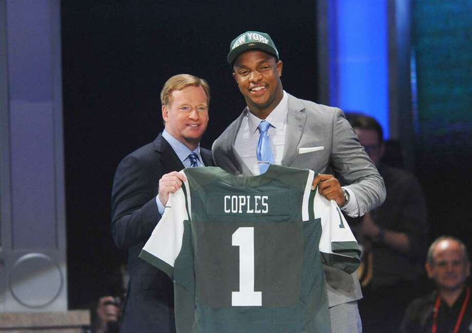 Apr 26, 2012; New York, NY, USA; NFL commissioner Roger Goodell introduces defensive end Quinton Coples (North Carolina) as the 16th overall pick by the New York Jets in the 2012 NFL Draft at Radio City Music Hall. Mandatory Credit: James Lang-US PRESSWIRE Photo: US PRESSWIRE / James Lang