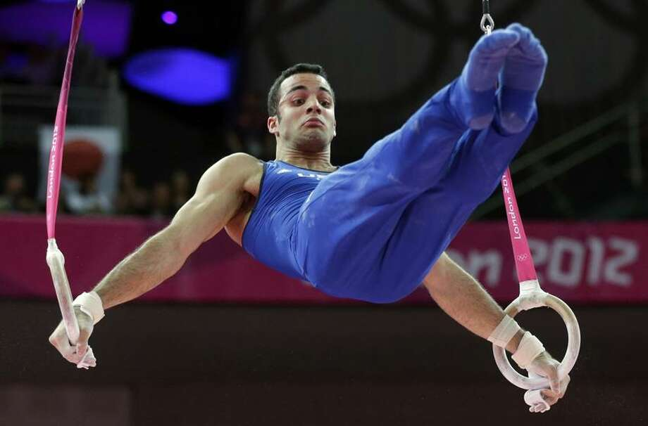 U.S. gymnast Danell Leyva performs on the rings during the artistic gymnastics men's individual all-around competition at the 2012 Summer Olympics, on Wednesday. Leyva earned the bronze medal, only the second all-around medal for a U.S. man since 1984. (AP photo) Photo: AP / AP2012