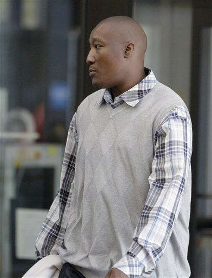 Lonnie Simpson, half-brother of singer and actress Jennifer Hudson, leaves the Cook County Criminal Courts Building in Chicago after testifying on the second day of the trial of William Balfour, who is charged in the October 2008 murders of Hudson's mother, brother and nephew. Associated Press Photo: AP / AP