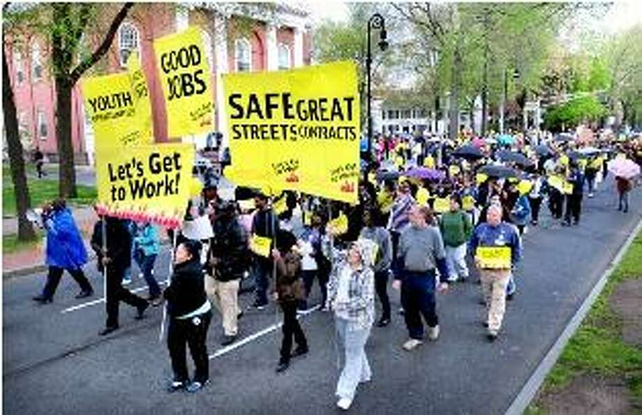 A jobs march heads down Temple St. in New Haven on Wednesday night 4/25/2012. Photo by Arnold Gold/New Haven Register