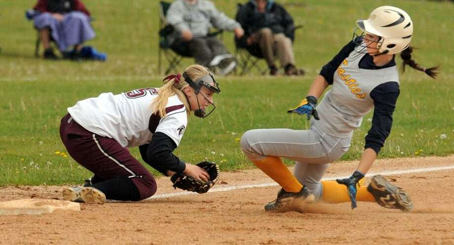 East Haven's Gabby Comesanas is about to slide in safely as North Haven third baseman Kristyn Cullen tries to make the play. Mara Lavitt/New Haven Register