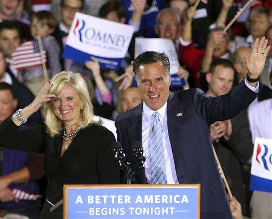 Republican presidential candidate, former Massachusetts governor Mitt Romney and his wife Ann wave to supporters Tuesday, April 24, 2012, in Manchester, N.H. (AP Photo/Jim Cole) Photo: AP / AP