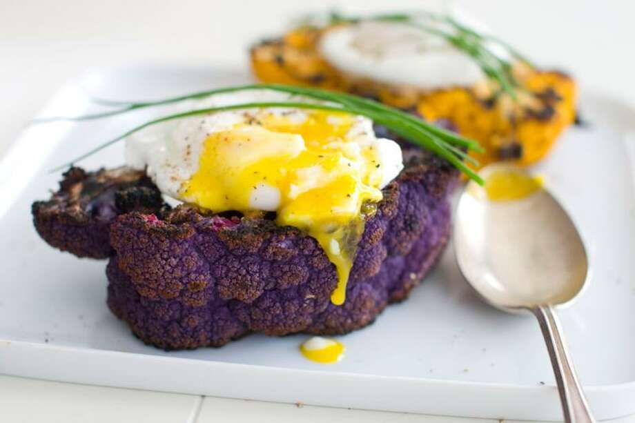 Matthew Mead/Associated Press photo: Grilled Cauliflower Steaks With Poached Eggs and Truffle Oil Photo: AP / AP2012