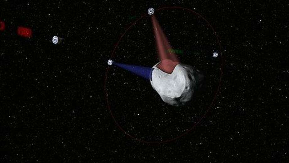 This computer-generated image provided by Planetary Resources, a group of high-tech tycoons that wants to mine nearby asteroids, shows a conceptual rendering of satellites prospecting a water-rich, near-Earth asteroid. The group's mega-million dollar plan is to use commercially built robotic ships to squeeze rocket fuel and valuable minerals like platinum and gold out of the lifeless rocks that routinely whiz by Earth. One of the company founders predicts they could have their version of a space-based gas station up and running by 2020. (AP Photo/Planetary Resources) Photo: AP / Planetary Resources