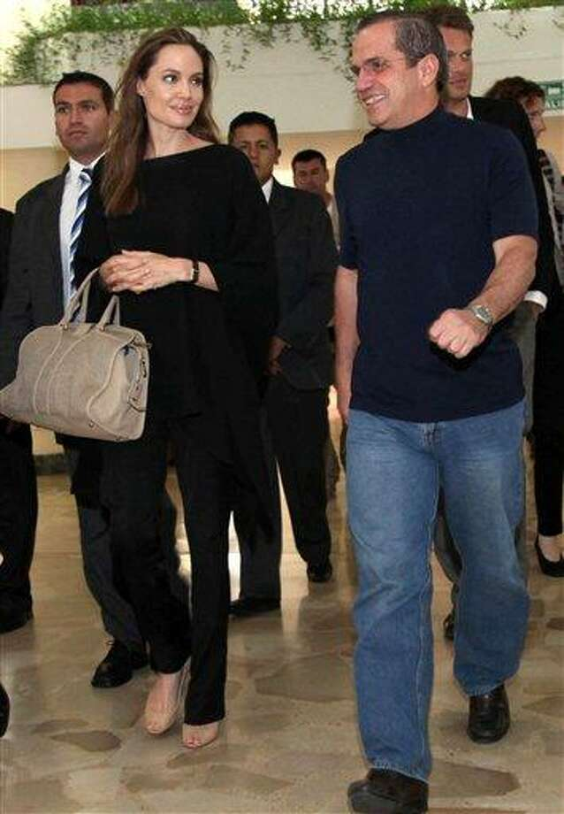 "In this photo released by Ecuador's Foreign Ministry, Ecuador's Foreign Minister Ricardo Patino, right, and U.S. actress and UNHCR's Goodwill Ambassador Angelina Jolie walk together before attending a meeting in Quito, Ecuador, Sunday, April 22, 2012. Jolie met on Sunday Patino to start the campaign ""Thanks Ecuador,"" promoted by the Office of the United Nations High Commissioner for Refugees, UNHCR, in recognition of the work of the Andean country in support of refugees. Photo: AP / Ecuador's Foreign Minister"
