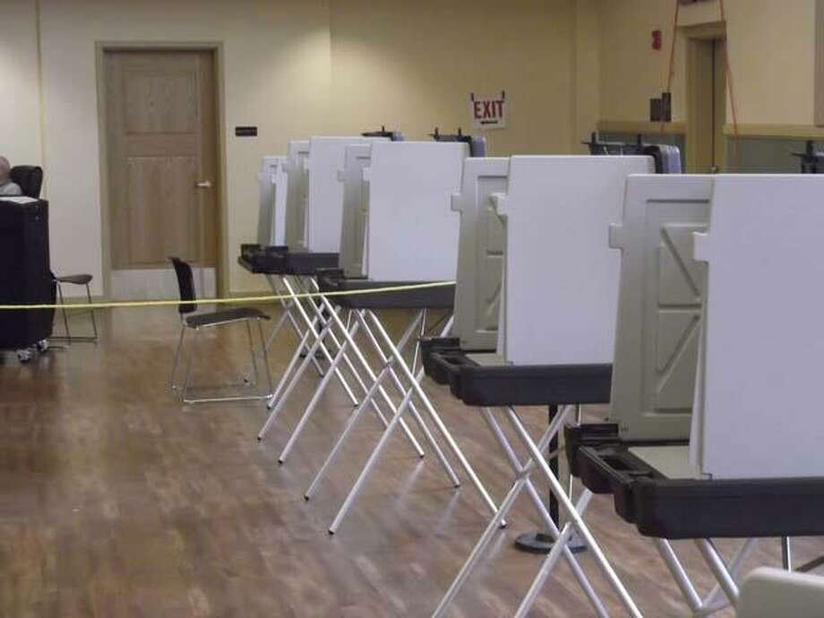 The polls closed at 8 p.m. in Torrington City Hall for the 2012 Republican Presidential Preference Primary, but a few hours before closing, the city hall auditorium was a voter ghost town. Torrington reported under 10 percent of registered Republican voters turning out Tuesday to vote in a race nearly clinched by presidential hopeful Mitt Romney. (RICKY CAMPBELL / Register Citizen)