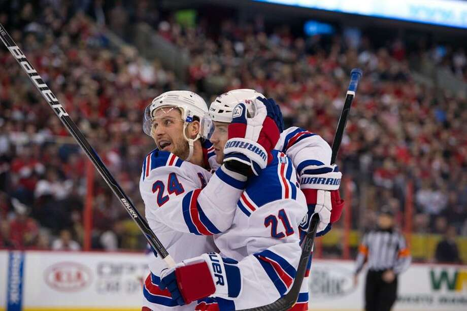 Apr 23, 2012; Ottawa, ON, CAN; New York Rangers right wing Ryan Callahan (24) and centre Derek Stepan (19) celebrate goal scored against the Ottawa Senators in the second period at Scotiabank Place. Mandatory Credit: Marc DesRosiers-US PRESSWIRE Photo: US PRESSWIRE / Marc DesRosiers