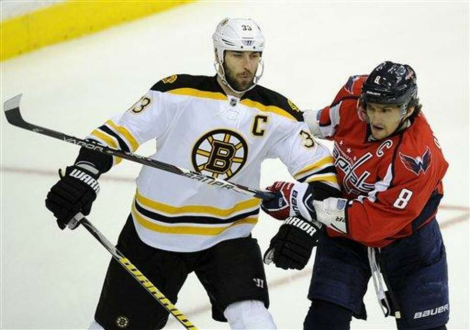 Washington Capitals left wing Alex Ovechkin (8), of Russia, tangles with Boston Bruins defenseman Zdeno Chara (33), of Slovakia, during the first period of Game 6 of an NHL hockey Stanley Cup first-round playoff series, Sunday, April 22, 2012, in Washington. (AP Photo/Nick Wass) Photo: AP / FR67404 AP