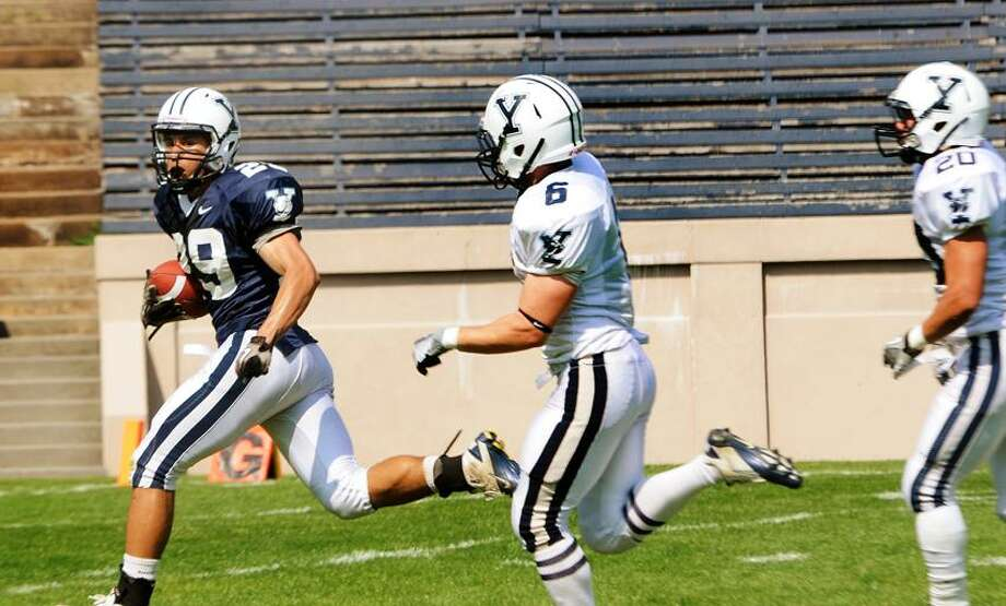 Yale's Grant Wallace scores a third quarter touchdown during Saturday's Blue-White scrimmage at the Yale Bowl. Melanie Stengel/Register