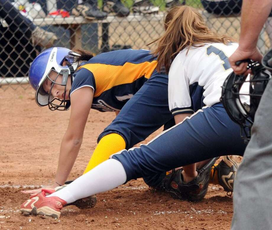 Brookfield at Lauralton Hall, softball, 1st inning: Lauralton's pitcher Hayley Spragg makes the out at home against Brookfield's Danielle DeMarco. Mara Lavitt/New Haven Register4/18/12