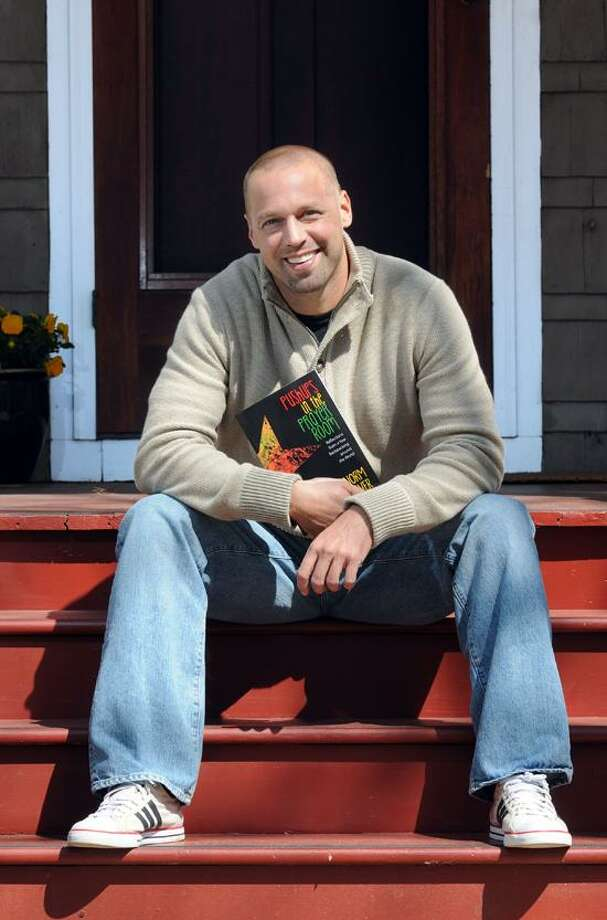 Norm Schriever on the steps to his mother's house in Hamden. Schriever took a year in Costa Rica to write a memoir of backpacking all over the world a decade ago. Mara Lavitt/New Haven Register