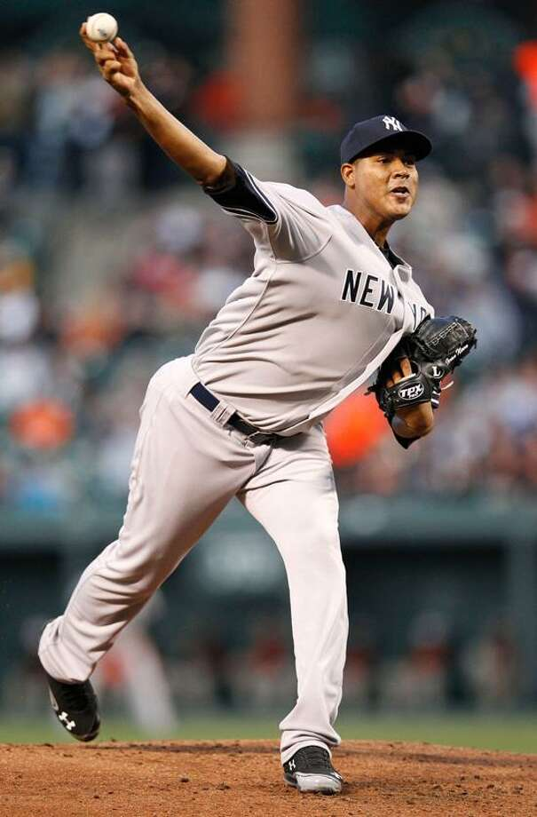 New York Yankees starting pitcher Ivan Nova throws against the Baltimore Orioles in the first inning of a baseball game in Baltimore, Monday, April 9, 2012. (AP Photo/Patrick Semansky) Photo: AP / AP2012