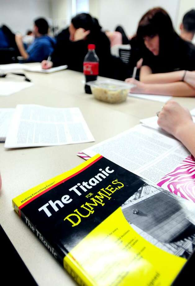 Students take notes during a class on the Titanic taught by Stephen Spignesi, author of Titanic for Dummies, at the University of New Haven. Arnold Gold/Register