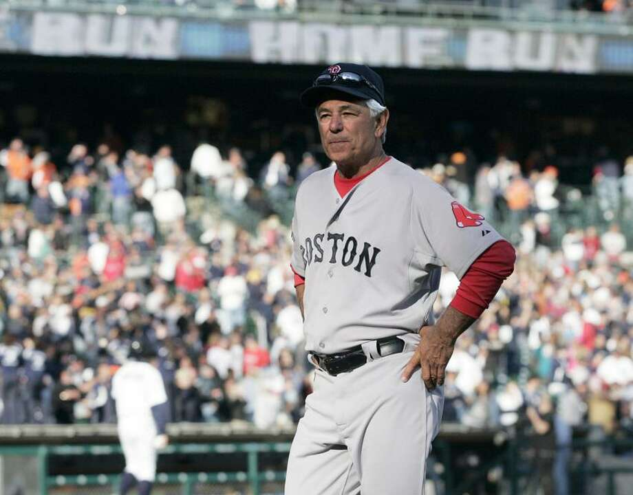Boston Red Sox manager Bobby Valentine walks off the field after the Detroit Tigers' 13-12 win on Alex Avila's two-run home run in the 11th inning of a baseball game Sunday, April 8, 2012, in Detroit. (AP Photo/Duane Burleson) Photo: AP / AP2012