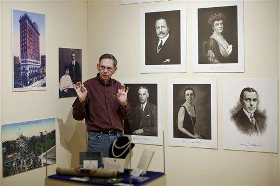 In this April 3, 2012 photo, Emeritus Professor Joseph Edgette discusses the new Titanic exhibit during an interview with The Associated Press, in view of portraits of members of the Widener family, at Widener University, in Chester, Pa. The exhibition is scheduled to run from April 10 to May 12. As the world marks the 100th anniversary of the tragedy this week, Edgette is writing a book that documents the final resting places of all the ship's passengers. He holds a doctorate in folklore and specializes in gravestones and cemeteries. ( AP Photo/Matt Rourke) Photo: AP / AP