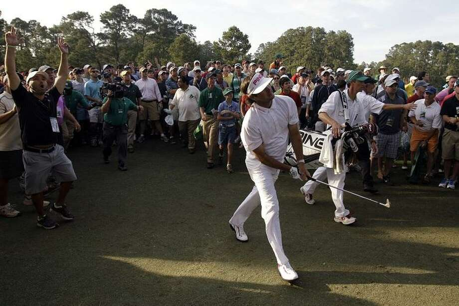 Bubba Watson watches his shot from the rough off the 17th hole during the fourth round of the Masters golf tournament Sunday, April 8, 2012, in Augusta, Ga. (AP Photo/Matt Slocum) Photo: ASSOCIATED PRESS / AP2012