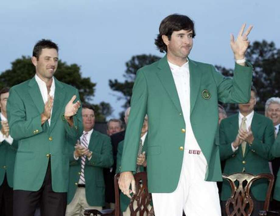 Charl Schwartzel, left, of South Africa, applauds after helping Bubba Watson put on the green jacket after winning the Masters golf tournament following a sudden death playoff on the 10th hole Sunday, April 8, 2012, in Augusta, Ga. (AP Photo/Charlie Riedel) Photo: ASSOCIATED PRESS / AP2012