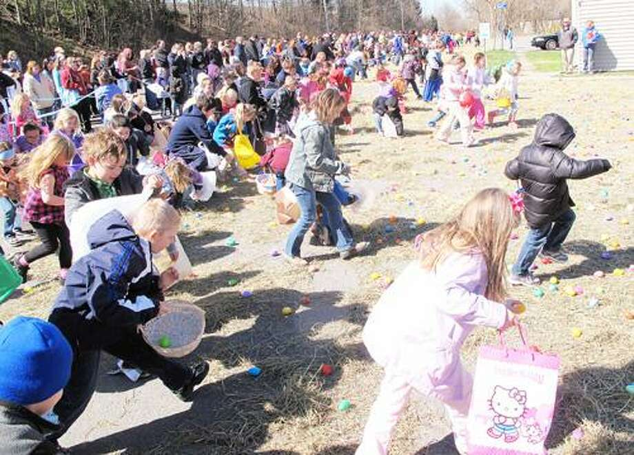 Photo by JOHN HAEGER (Twitter.com/OneidaPhoto) Children race to find some of the 6,500 eggs during the annual Easter Egg Hunt in Lenox on Saturday, April 7, 2012.