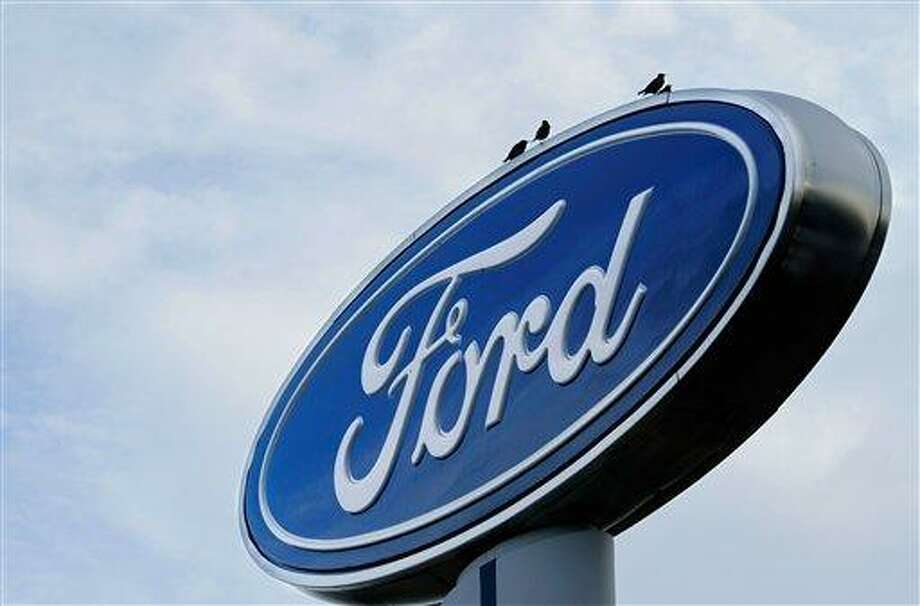 FILE - In this July 24, 2011 file photo, the Ford logo is displayed at an auto dealership in Springfield, Ill. Ford says it will spend $600 million to expand its factory capacity in China as it tries to play catch-up with competitors. The company says it will add to its factories in Chongqing to handle growing demand. The additions will give Ford the ability to make 350,000 more vehicles per year by 2014. (AP Photo/Seth Perlman, File) Photo: ASSOCIATED PRESS / AP2011