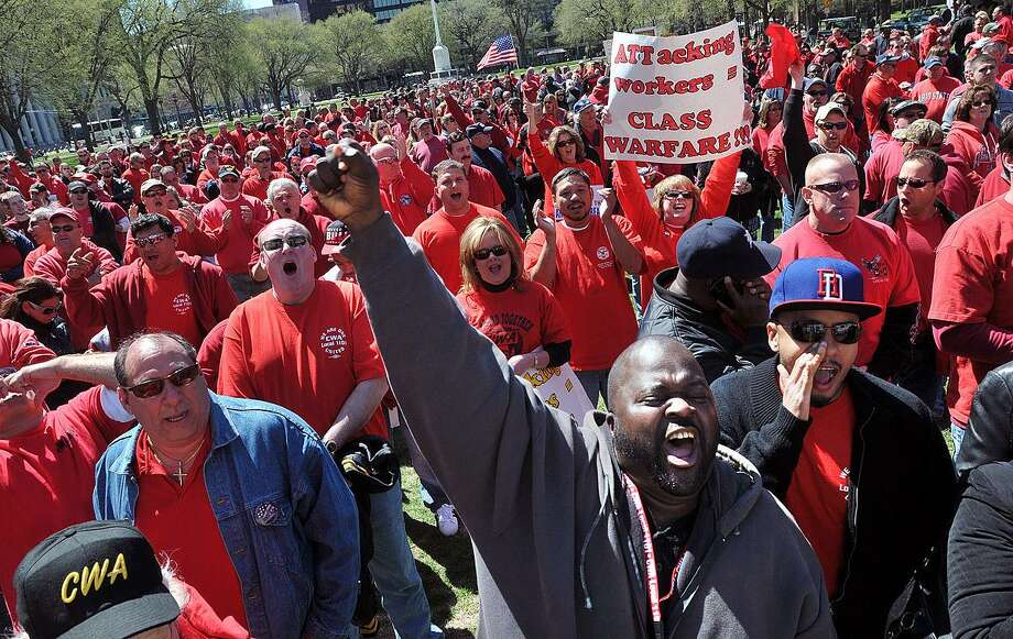 Bryan Raymond, an AT&T 1101 Union worker, cheers with the crowd as AT&T union workers and supporters held a rally on the New Haven Green in unity with ongoing contract negotiations with workers nationwide. Raymond is from Brooklyn, N.Y.