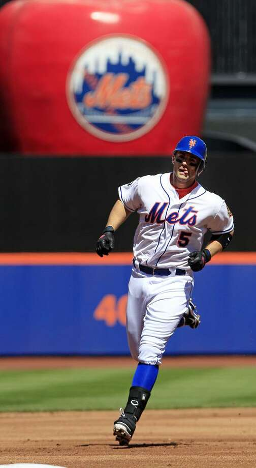 New York Mets' David Wright runs the bases after hitting a home run during the first inning of a baseball game against the Atlanta Braves Saturday, April 7, 2012, in New York.  (AP Photo/Frank Franklin II) Photo: AP / AP2012