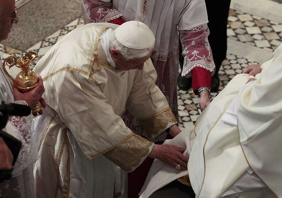Honoring an ages-old tradition on Holy Thursday, Pope Benedict XVI. center, washes the feet of an unidentified layman, during the rite of the washing of the feet in St. John Lateran Basilica in Rome. Associated Press Photo: AP / AP