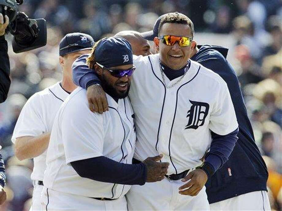 Detroit Tigers' Prince Fielder, left, and Miguel Cabrera walk off the field after their 3-2 win over the Boston Red Sox in a baseball game in Detroit, Thursday, April 5, 2012. (AP Photo/Carlos Osorio) Photo: AP / AP