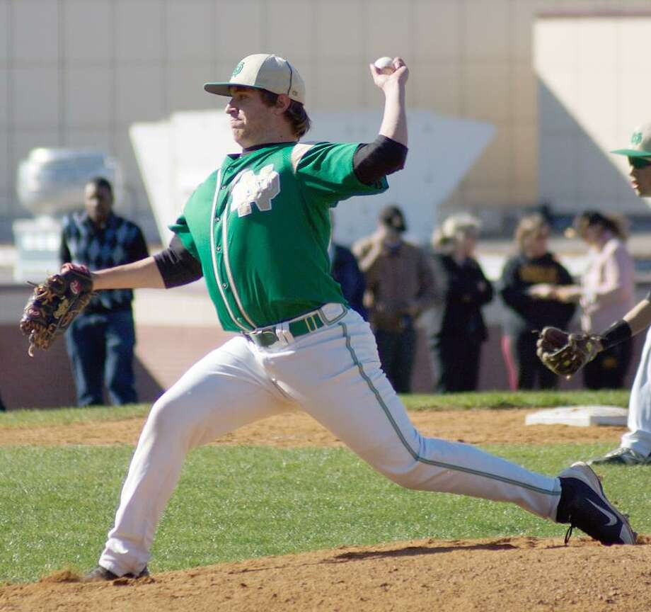 Woodbridge-- Notre Dame's Matthew Elia delivers during the first inning. Photo- Peter Casolino/New Haven Register 04/05/12