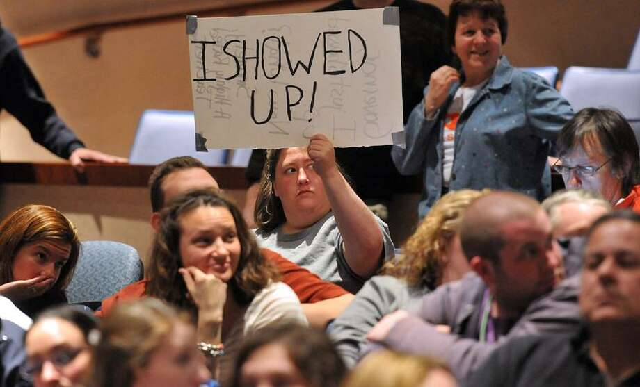 Career High (New Haven) English teacher Jennifer Drury holds a sign as Gov. Dannel P. Malloy speaks to the crowd at Ansonia High School on his 10th stop promoting his principles of education reform. Peter Casolino/Register