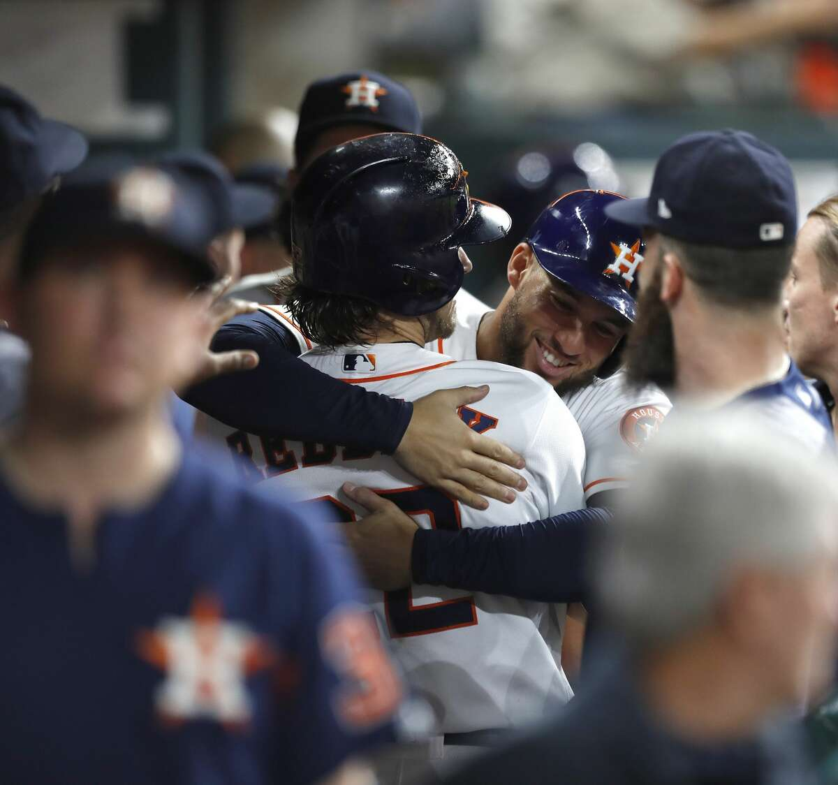 Houston Astros Josh Reddick (22) celebrates his two-run home run in the dugout with George Springer during the eighth inning of an MLB game at Minute Maid Park, Wednesday, Aug. 16, 2017, in Houston. ( Karen Warren / Houston Chronicle )