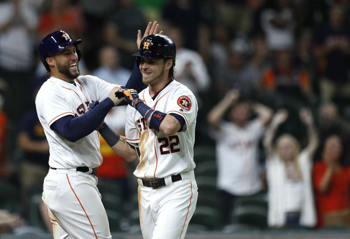 Houston Astros Josh Reddick (22) celebrates his two-run home run with George Springer during the eighth inning of an MLB game at Minute Maid Park, Wednesday, Aug. 16, 2017, in Houston. ( Karen Warren / Houston Chronicle )