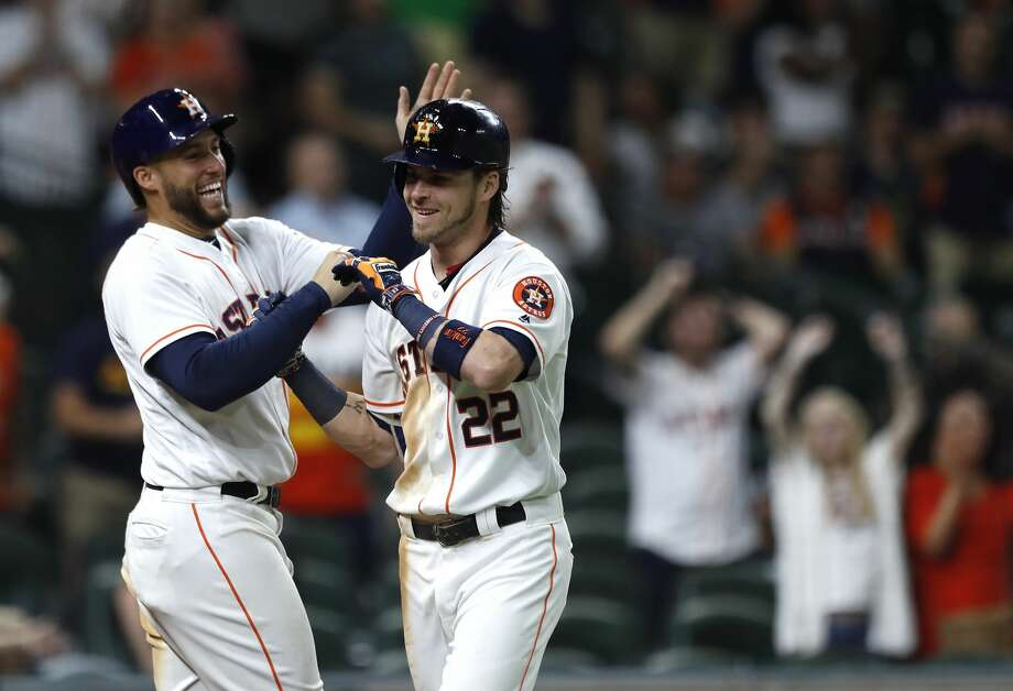 Houston Astros Josh Reddick (22) celebrates his two-run home run with George Springer during the eighth inning of an MLB game at Minute Maid Park, Wednesday, Aug. 16, 2017, in Houston.  ( Karen Warren / Houston Chronicle ) Photo: Karen Warren/Houston Chronicle