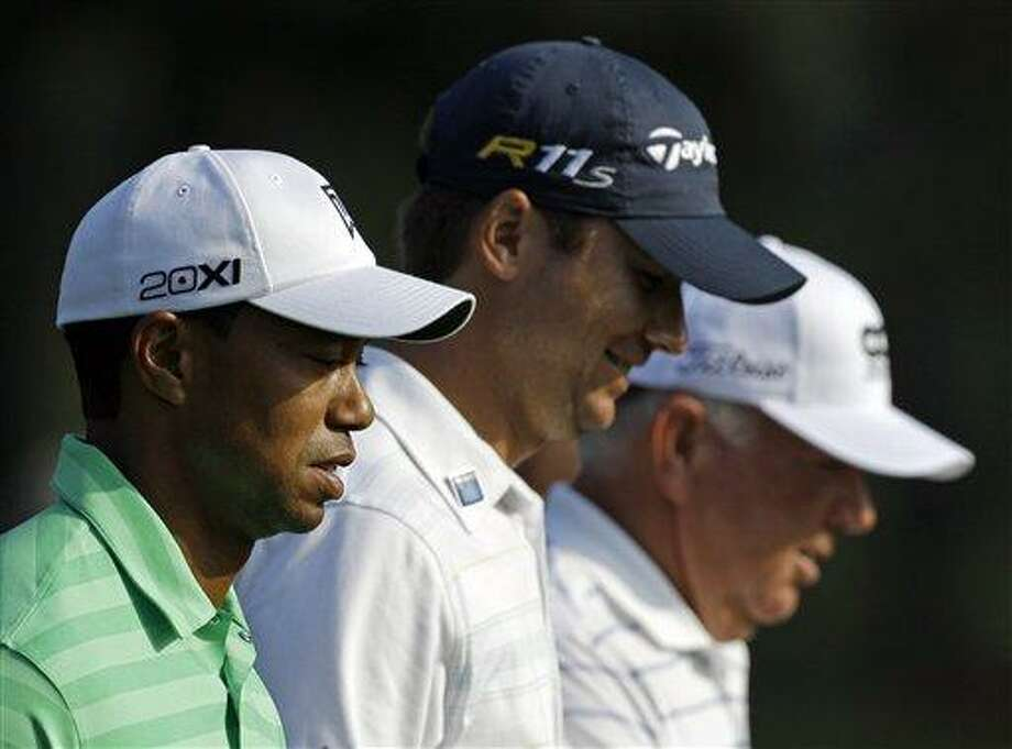 Tiger Woods, Sean O'Hair and Mark O'Meara walk down the 14th hole during a practice round for the Masters golf tournament Wednesday, April 4, 2012, in Augusta, Ga. (AP Photo/Matt Slocum) Photo: AP / AP
