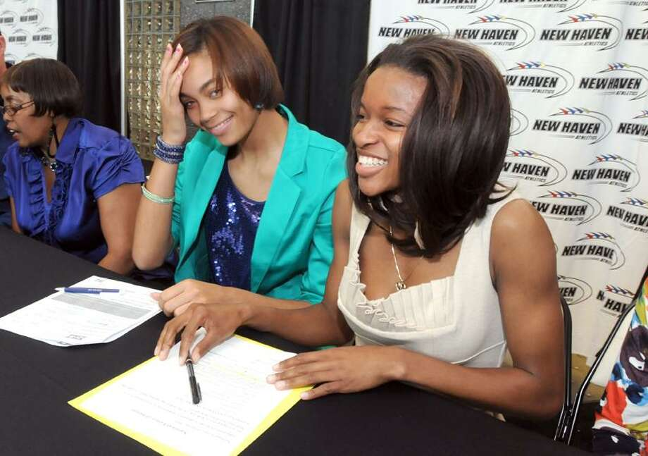 Floyd Little Athletic Center, New Haven: Hillhouse's Brianna Sims left and Career's Paris Taft signed letters of intent to their colleges for track. Sims will be attending Delaware State and Taft will attend UConn. Mara Lavitt/New Haven Register4/4/12