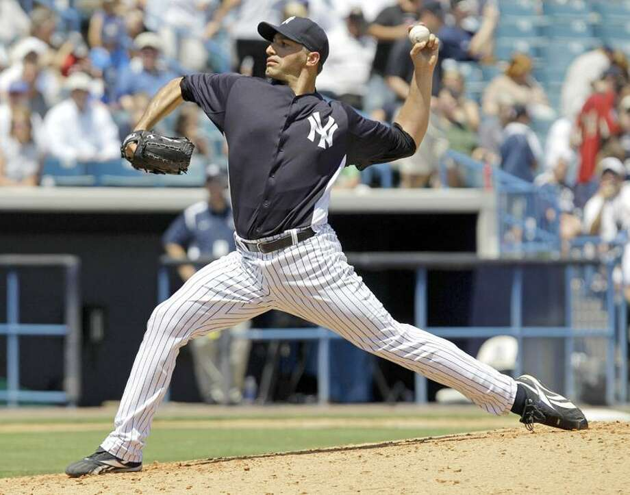 New York Yankees starting pitcher Andy Pettitte delivers against the New York Mets during a spring training baseball game at Steinbrenner Field in Tampa, Fla., Wednesday, April 4, 2012.  It was Pettitte's first appearance in a spring training game after coming out of retirement to rejoin the Yankees.  (AP Photo/Kathy Willens) Photo: AP / AP2012