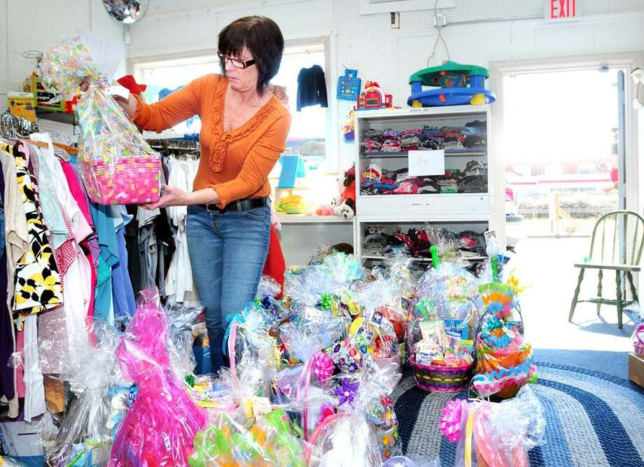 Sandi Bailie, director of Saint Vincent DePaul Helping Hands of the Valley Thrift Shop and Food Pantry in Derby, picks out Easter baskets for distribution to Arnold Gold/Register