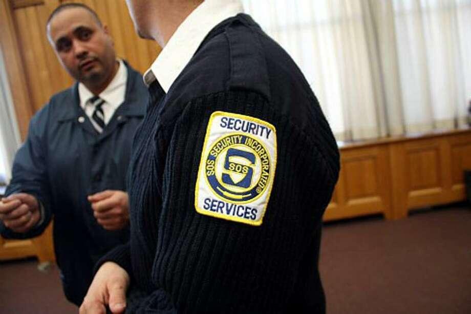 SOS Security Guards. Michael Lee-Murphy photo