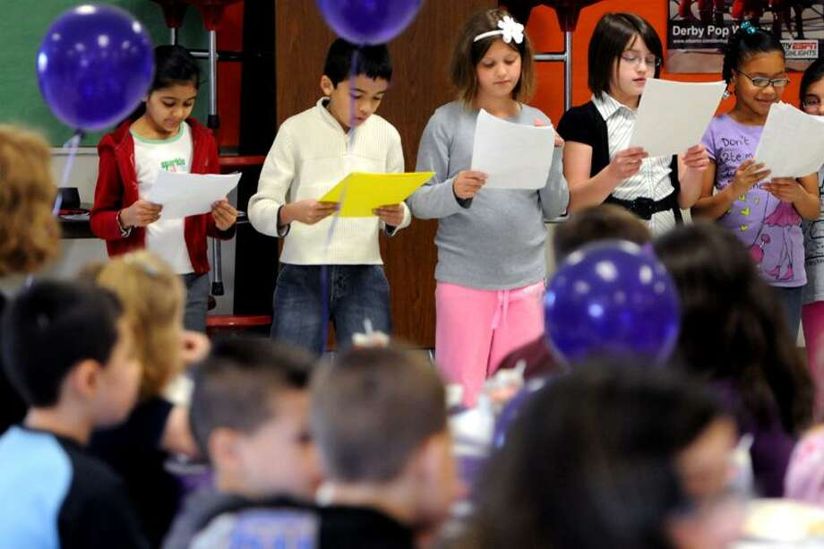 Students at Bradley Elementary School in Derby read to author Suzy Kline from a Reader's Theater excerpt. Peter Hvizdak/Register Photo: New Haven Register / ©Peter Hvizdak /  New Haven Register