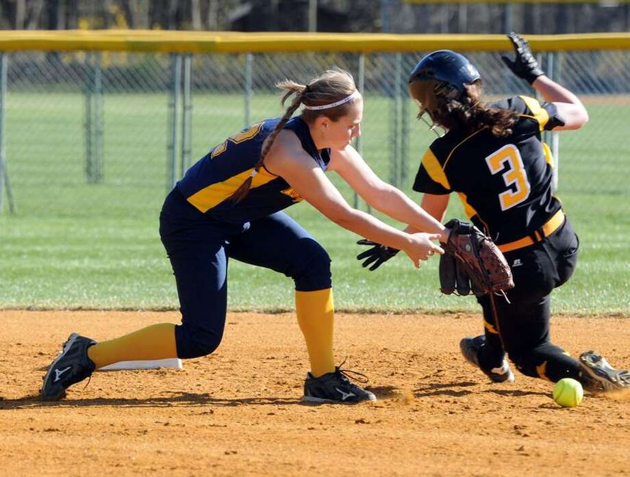 Mercy's Tori Vickerman drops the ball as Amity's Corina Zdrowski slides safely into second base in the second inning of Amity's 6-0 win.  Mara Lavitt/New Haven Register