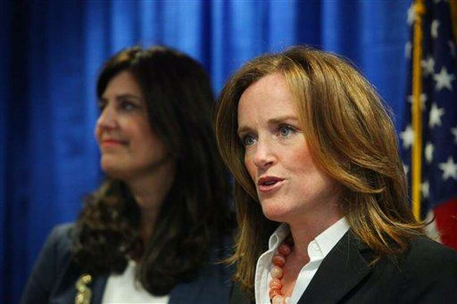 Nassau County District Attorney Kathleen Rice, right, joins Kathryn Juric, Vice President of the College Board for the SAT Program, as they announce a national test security overhaul to prevent cheating on the SAT exams, in Mineola, N.Y.  Associated Press Photo: AP / Newsday