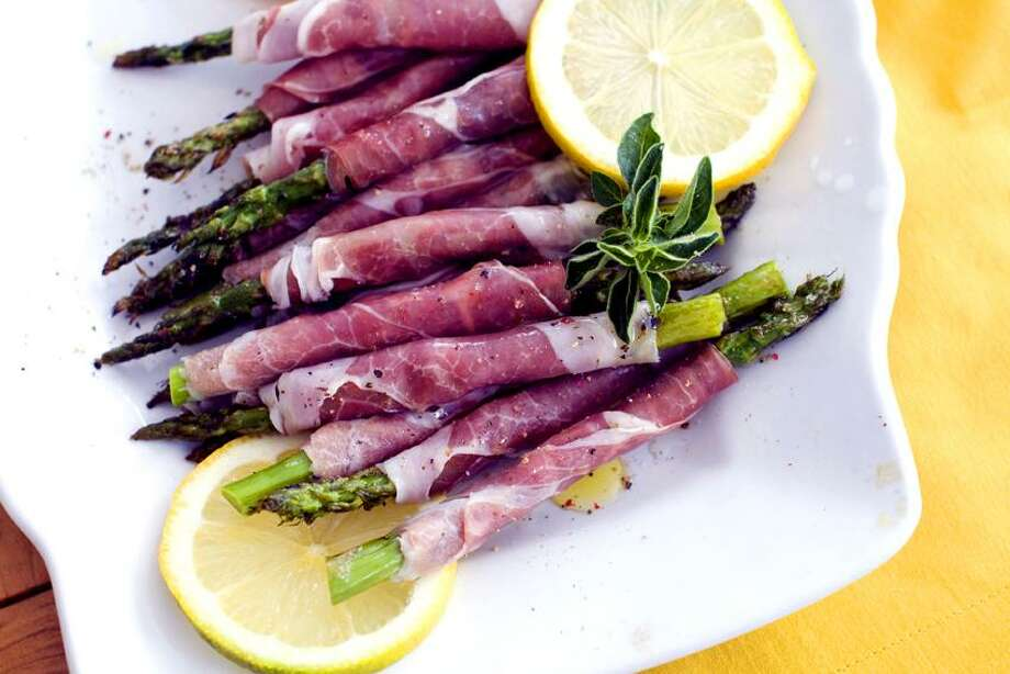 Matthew Mead/Associated Press photo: Prosciutto-Wrapped Grilled Spring Asparagus Photo: AP / AP2012