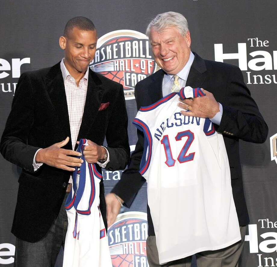 Naismith Memorial Basketball Hall of Fame inductees Reggie Miller, left, and Don Nelson, smile as they are introduced at a news conference in New Orleans, Monday, April 2, 2012. (AP Photo/Gerald Herbert) Photo: AP / AP2012