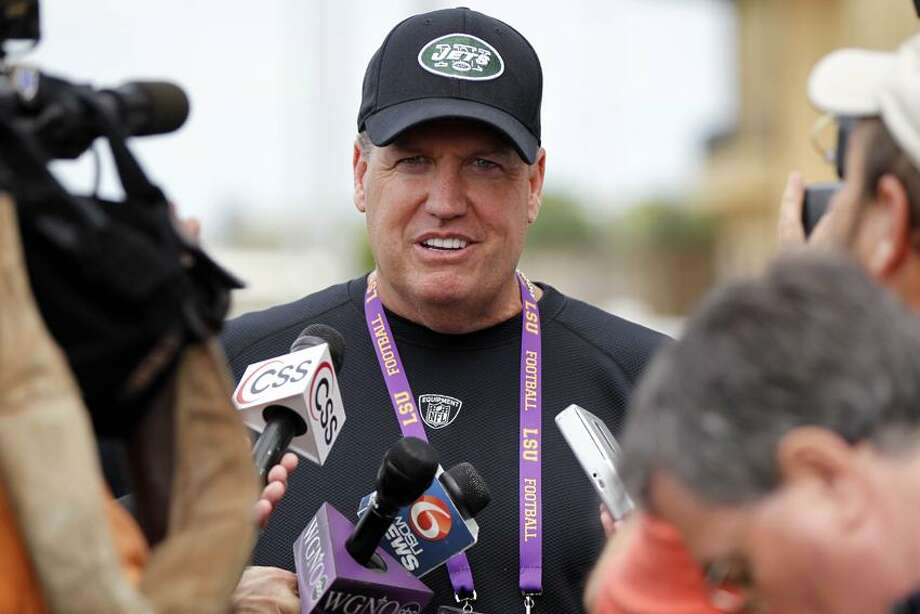 New York Jets head coach Rex Ryan talks to reporters about acquiring NFL quarterback Tim Tebow from the Denver Broncos at the LSU  football Pro Timing Day in Baton Rouge, Thursday, March 22, 2012. (AP Photo/Gerald Herbert) Photo: AP / AP2012
