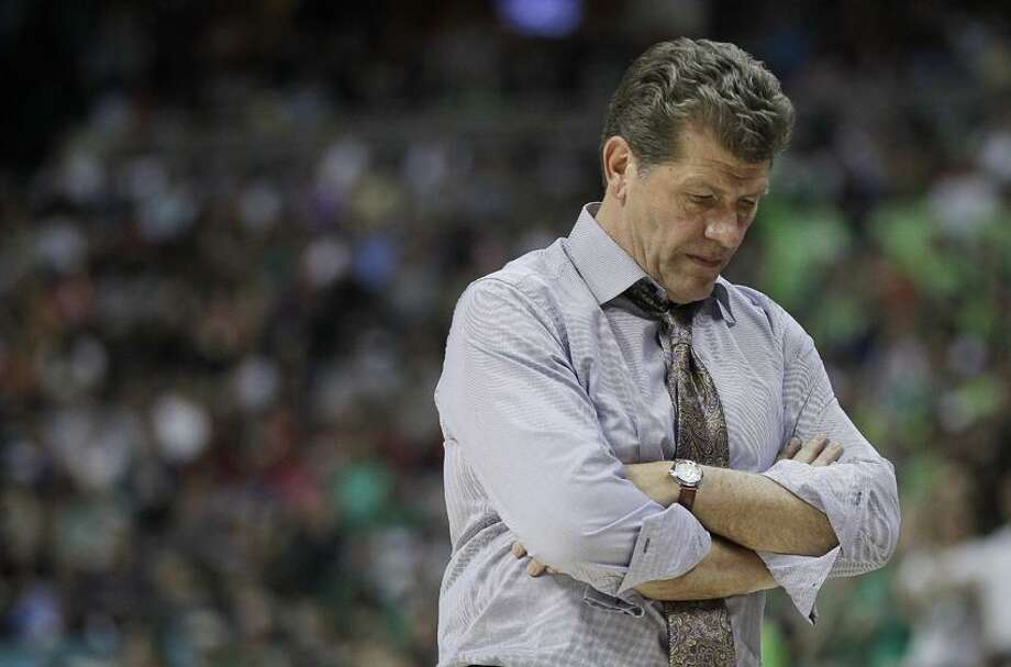 Connecticut head coach Geno Auriemma walks near the bench during overtime in the NCAA women's Final Four semifinal college basketball game against Notre Dame, in Denver, Sunday, April 1, 2012. Notre Dame won 83-75. (AP Photo/Julie Jacobson) Photo: AP / AP2012