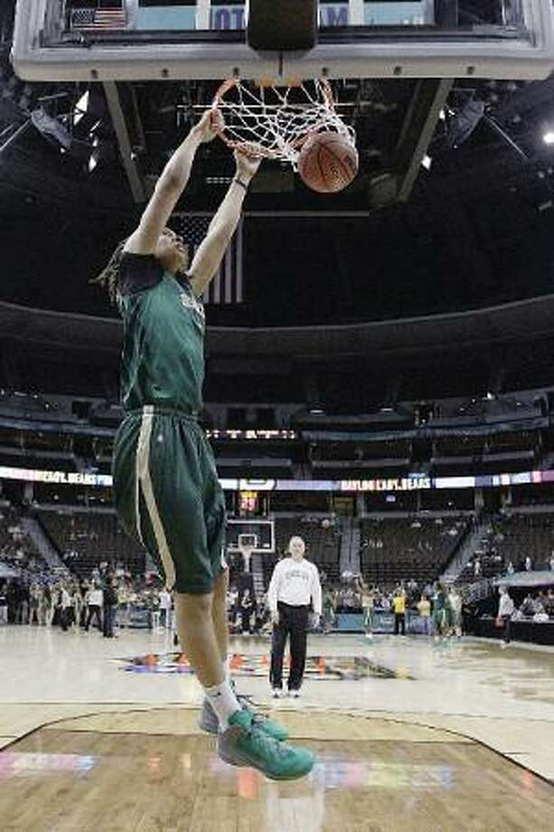 ASSOCIATED PRESS Baylor center Brittney Griner dunks during practice for the Women's Final Four in Denver Saturday. Baylor takes on Stanford in a national semifinal tonight.