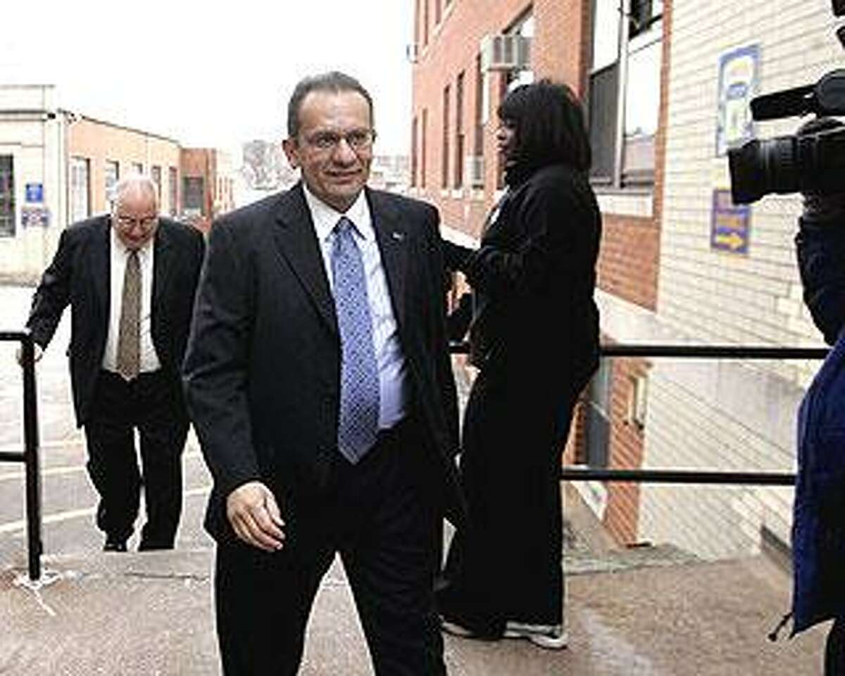 Hartford Mayor Eddie Perez arrives at Connecticut State Police Troop H building in Hartford, Tuesday, to turn in himself in. Perez was charged Tuesday with receiving a bribe and falsifying evidence after he turned himself in to state police. (AP Photo/Bob Child)