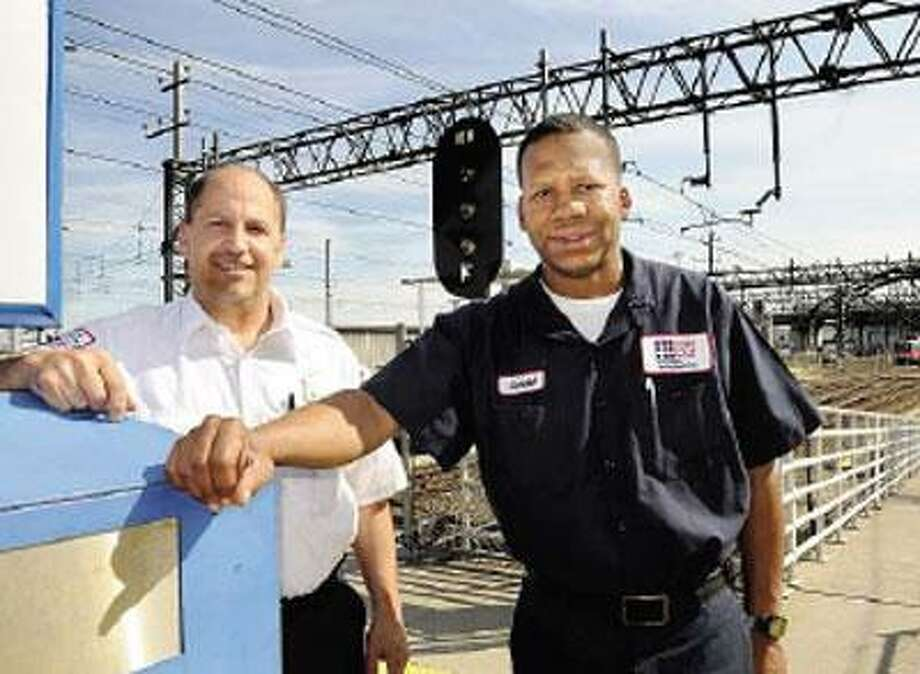 Joe Mortali, left, and Gerald McCray received awards for helping to prevent a suicide at New Haven's Union Station. (Melanie Stengel/Register)
